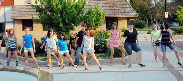 There was a flash mob dance group at June's Art Walk. The Baldwin Community Arts Council is planning another surprise for Friday's July event.