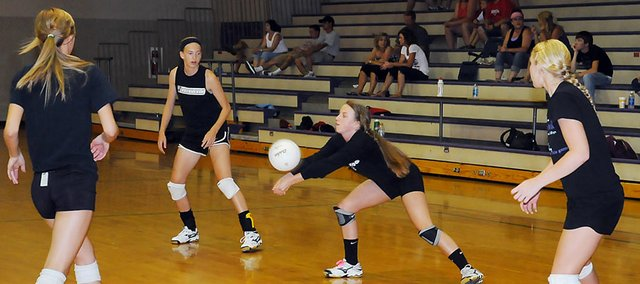 Baldwin High School sophomore Madeline McCrary passes the ball during a summer league game recently. The Bulldogs played Santa Fe Trail and Osage City during their summer league contests.