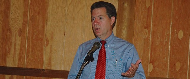 Kansas Gov. Sam Brownback speaks during the National Agricultural Center and Hall of Fame&#39;s Board of Governors annual meeting reception Monday. He said he would support the Ag Hall as much as he could, but that wouldn&#39;t extend to financial support 