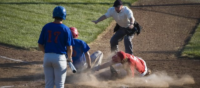 Wellsville scores a run on a wild pitch as Post 41 starting pitcher Dylan Fosdick covers the plate in the top of the fourth inning Tuesday night at Eisenhower Park in Kansas City, Kan. Tonganoxie's season ended with an 8-6 loss to Wellsville at the Class AA Zone 2 tournament.