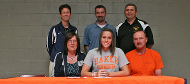 Megan Bergstrom, a 2011 Basehor-Linwood High School graduate, recently signed a letter of intent to play basketball at Baker University. Pictured at the signing ceremony are, from left, front row: Cathy Bergstrom, mother; Megan Bergstrom; Randy Bergstrom, father: and, back row: Susan Decker, former BU coach; Noah Simpson, BLHS head coach; and Bruce Courtney, BLHS assistant coach.