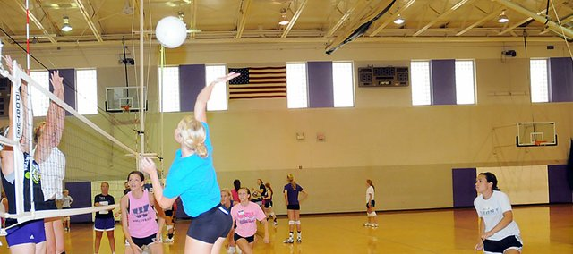 Baldwin High School senior Lakyn Clark swings to spike a ball during a drill at volleyball camp Friday afternoon. The Bulldogs shared their camp with Santa Fe Trail last week.