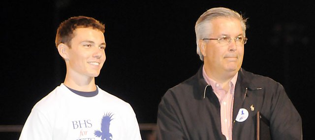 Colin Thomas, left, and Baldwin City Mayor Ken Wagner listen to patriotic music before speaking at the Baldwin High School Veterans Day ceremony in the fall. Thomas, who graduated from BHS in May, is working as an intern with Congresswoman Lynn Jenkins.