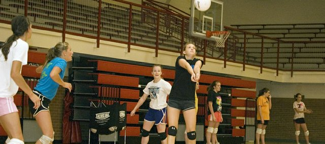 Sagan Scates gets ready to make a pass at Tonganoxie High volleyball camp in June. The Chieftains went 11-3 at their summer league in June and July.