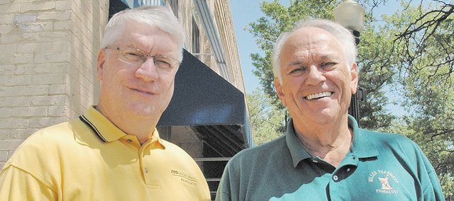 Larry Courtney (left) and Roger Miller officially will sell their business, Miller Pharmacy, to DeGoler Pharmacy of Kansas City, Kan., on Aug. 15. The Miller Pharmacy sign has graced downtown Bonner Springs for 47 years.