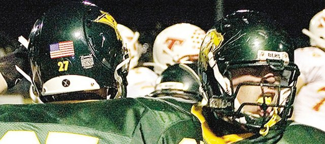 Caleb Johnson, right, barks at the Basehor-Linwood sideline after making a tackle during a victory against Tonganoxie. Johnson was a four-year letterman in football at BLHSand was named the schools Male Senior Athlete of the Year.