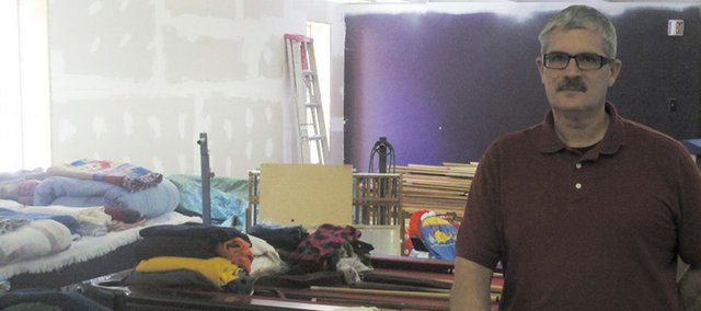 "Pastor Ed Fuller said volunteers at Bible Baptist Church in Bonner Springs have been busy sorting donations of clothes and household items brought in for the church's ""Neighbor Helping Neighbor"" giveaway event, set for Aug. 6."
