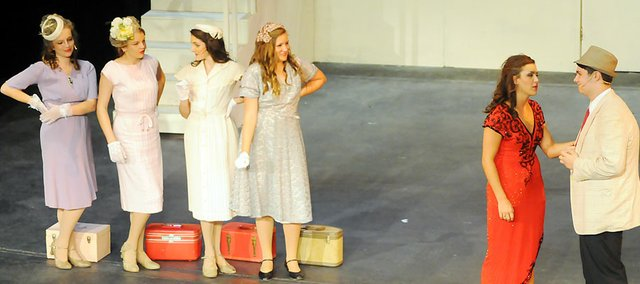 """Tony Ponella, far right, and Mayme Marshall act out a scene from the Broadway to Baker musical """"Anything Goes"""" July 17 at Rice Auditorium. Ponella played the role of Billy Crocker, while Marshall portrayed Reno Sweeney."""