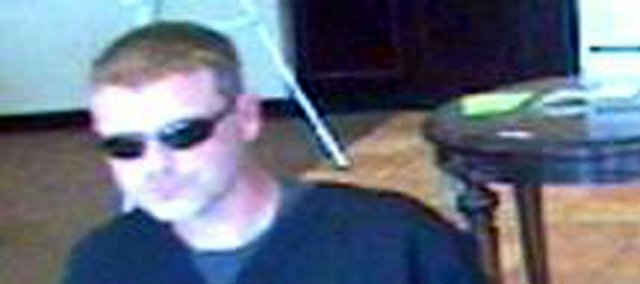 The FBI believes this man — captured on surveillance video prior to robbing an Olathe bank on Aug. 3 — is responsible for a July 25 bank robbery in Shawnee, as well as four Oklahoma heists and one in Joplin, Mo. The serial bank robber typically enters the banks shortly before the robbery, changes into a disguise with a fake beard, then returns to the bank to rob it, according to the FBI.