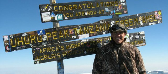 Matt Acree, a 2010 Mill Valley High School graduate and current Drake University football player, stands on the summit of Mount Kilimanjaro in Tanzania. Acree and his Drake teammates spent two weeks in May in Tanzania. While there, they played the first American football game on the African continent, performed volunteer work and then scaled the highest mountain on the continent. Even though he reached Kilimanjaro's Uhuru Peak at 19,340 feet, Acree says his most memorable moment was a two-day home stay with a Chagga tribe in which he helped build a school.