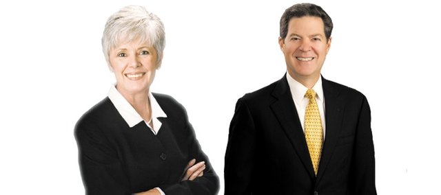 Kansas Insurance Commissioner Sandy Praeger, left, and Gov. Sam Brownback