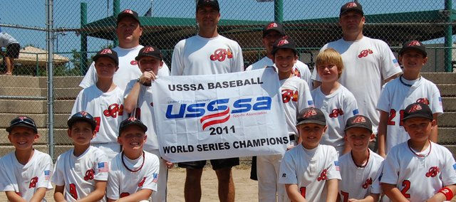 The Shawnee Braves 9-and-under AAA baseball team capped a stellar 33-9 season with a World Series championship last week in St. Louis, Mo. The Braves also finished the 2011 season as the top-ranked team in Kansas. Pictured are, from left, front row: Brian Garcia, Matthew Olson, Mason Sadler, Aden Eisentraut, Caden Barnard, Connor Simons; middle row: Chase Torkelson, Brendyn Bard, Quinton Hall, Cole Ondrush, Wyatt Wagner; and, back row: coach Shannon Sadler, manager Scott Wagner, coach Chris Garcia and coach Phil Eisentraut. Not pictured is Nate Adamson.