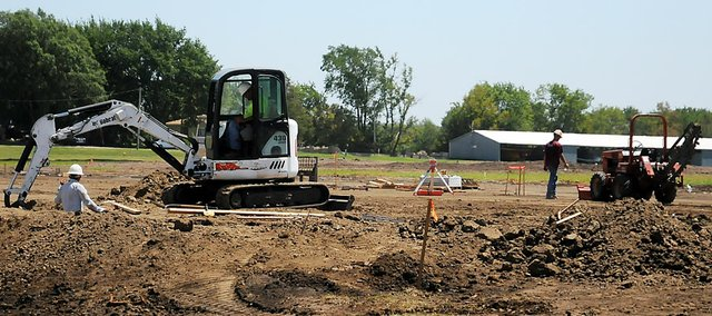 A construction crew works Tuesday on the land next to McFarlane Aviation's current building in Vinland. A second building will be constructed to allow McFarlane to expand and manufacture new and additional products for light aircrafts.