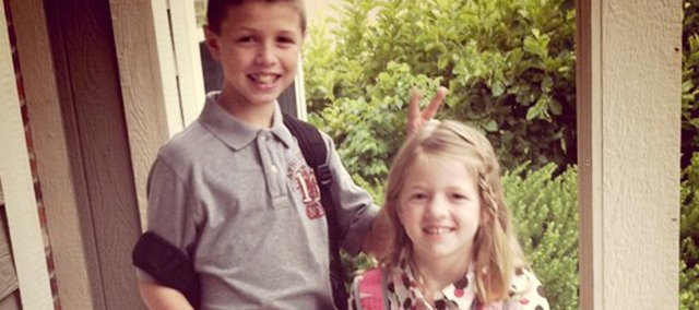 First day of school photo contributed by @ShawneeDispatch Twitter follower @DineandDish: 1st day of school... Be still my heart.
