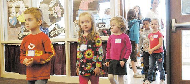 Kindergartners-to-be at Ray Marsh Elementary School in Shawnee file into the school library for a Cougar Cub Club event Feb. 18.Fast-forward six months, and the youngsters are now starting kindergarten.