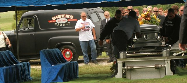 Tom Owens, Tonganoxie, left, pauses after driving his 1955 Ford Panel truck serving as the hearse carrying the remains of his nephew, Nick Owens, to the cemetery Wednesday.