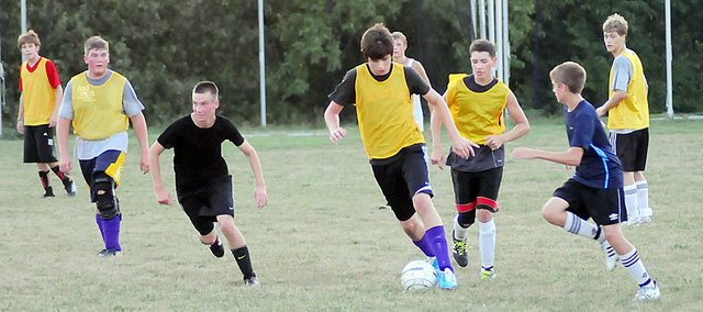 Members of the Baldwin High School boys' soccer team practice Tuesday evening on the field south of the Bulldogs' game field. Despite losing all girls to the spring girls' team, the Bulldogs have increased participation this fall.