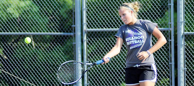Baldwin High School senior Hayley Schwartz returns a ball across the net during a practice drill Monday afternoon. Schwartz is one of four returning varsity players for the Bulldogs and one of three BHS players who competed at the state tournament last year.