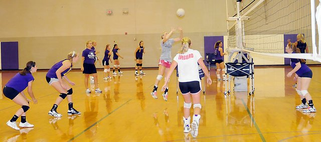 Baldwin High School volleyball players practice Monday afternoon during their first practice session of the 2011 season.