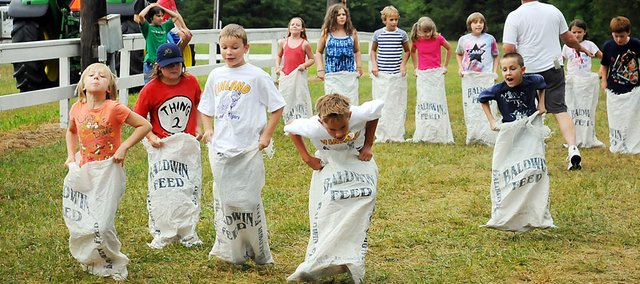 Sack races always draw a large number of children to the Vinland Fair on the second day. The sack races, bicycle races and tug-of-war are popular events every summer. Here, a handful of children race Friday afternoon.