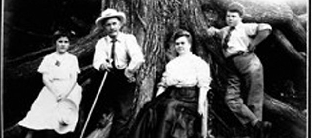 The family of Woodson McCoy poses at a base of a large tree in the early 1900s. The family acquired the land that was Woodsonia Farm near 60th Street and Kansas Highway 7 in the 1880s.