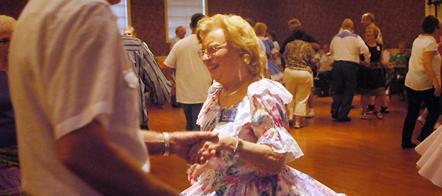 Dora Nation of Garden City, Mo., spins on the dance floor during a Swingin' Singles square dance at Shawnee Town Hall. This fall, the Swingin' Singles are offering lessons.