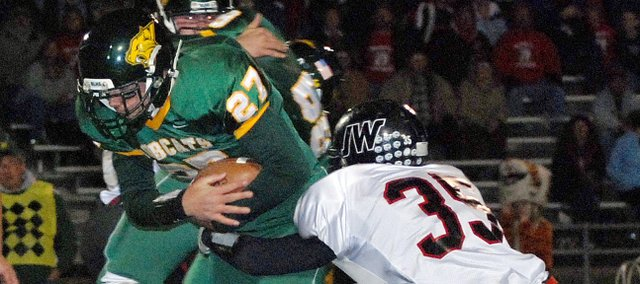 Jesse Hiss, Basehor-Linwood running back, plows up the middle during the Bobcats district game against Jefferson County West. Hiss will be looked to to play a greater role in the offense this season.