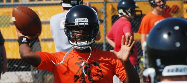 Jourdaine Smallwood, Bonner Springs senior quarterback, gives the Braves a passer who has an accurate arm but is also dangerous on the run.