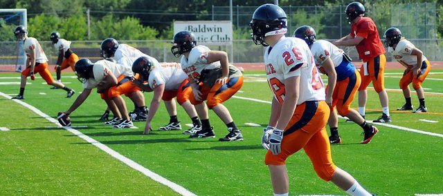 Members of the Baker University offensive team practice last week at Liston Stadium. Last week was the Wildcats' first official full week of practice after they started Aug. 13. Baker will play host to Ottawa University at 7 p.m. Saturday.