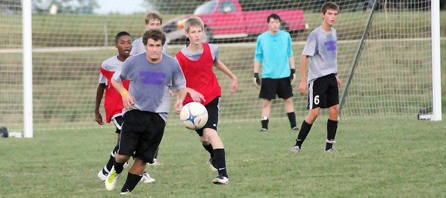 Members of the Baldwin High School soccer team scrimmage Friday evening. Coach Mark Joslyn was pleased with what he saw at the scrimmage. Joslyn and his players are ready to begin the season at Tonganoxie on Friday.