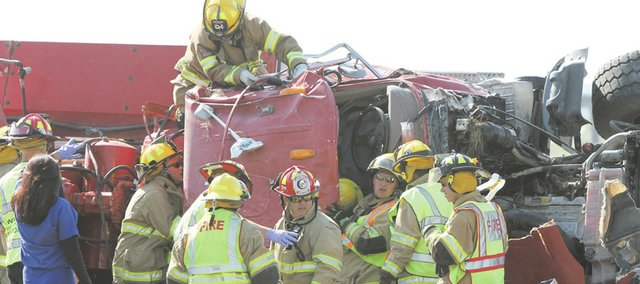 Douglas County Sheriff's deputies worked with Kansas Highway Patrol troopers and emergency personnel from Eudora and Lawrence to free a truck driver for Penny's Concrete from his rig about 4:30 p.m. on Thursday Aug. 25, 2011 near the Eudora exit on Kansas Highway 10 after it overturned, pinning him inside. The driver was flown by helicopter ambulance to an area hospital.