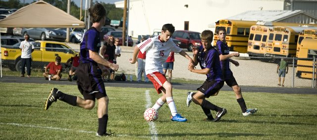 Tonganoxie High junior forward John Lean tries to hold off a Baldwin defender and control the ball while coming into the box late in the second half Friday. The Chieftains couldn&#39;t add a late score and tied Baldwin, 1-1.