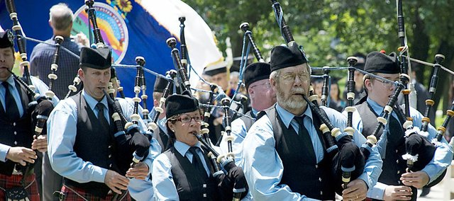 Members of the St. Andrews Pipes and Drums traditionally lead graduates across campus during May commencement ceremonies.