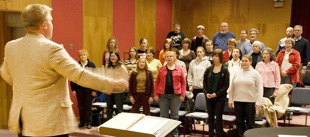 Matthew Potterton, assistant professor of music and director of choral activities at Baker, leads the community choir.