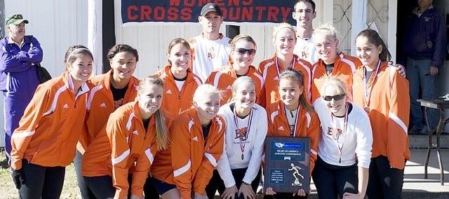 Baker University women's cross country team celebrated its Heart of America Athletic Conference championship last fall at the Baldwin City Municipal Golf Course.