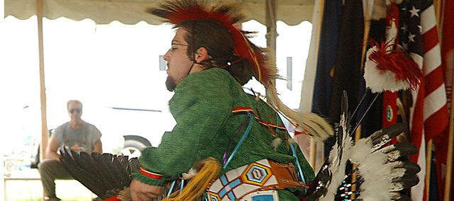 Kyle Robinson of Basehor displays his footwork during the intertribal dance Sunday at the Indian Council of Many Nation's powwow at the Leavenworth County Fairgrounds. Robinson learned the intricacies of Native American dance from Chester Henre, son of Tonganoxie Boy Scout leader Mike Henre, whose family is also responsible for much of his regalia.