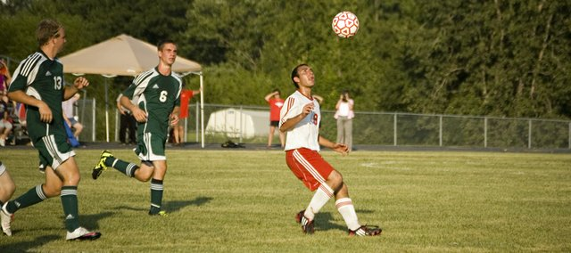 Tonganoxie High senior Joseph Parrino tracks the ball in the first half against Basehor-Linwood Thursday at THS. The Cheiftains won, 1-0, for their first victory of the season.