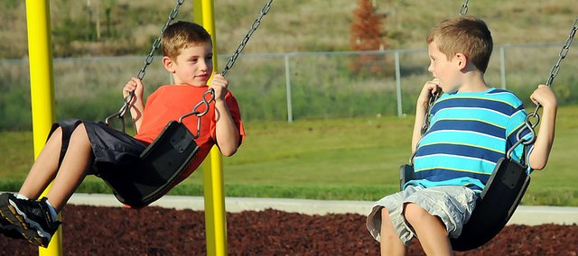 A pair of USD 348 elementary students swing together during the CSO picnic Aug. 25.