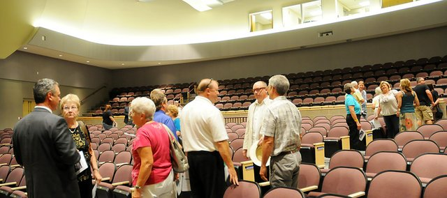 Brad Neuenswander, Kansas State Department of Education director of teaching and learning, left, chats with USD 348 patrons during Tuesday's open house and dedication for the Performing Arts Center.
