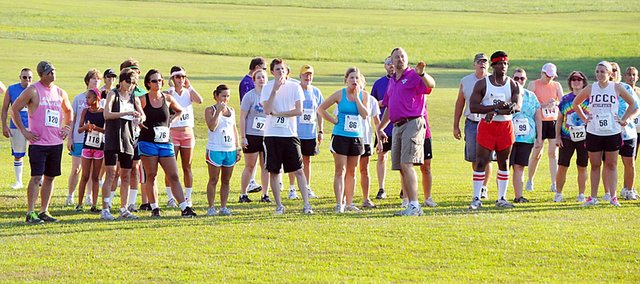 Baldwin High School coach Mike Spielman, center, gives course directions to the 5K participants before Saturday's race.