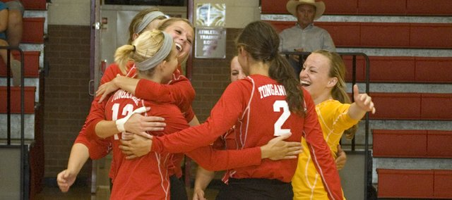 Tonganoxie High volleyball players celebrate after scoring the match-winning point Thursday night against visiting Paola. The Chieftains won, 25-18, 25-16, 22-25 and 25-14.