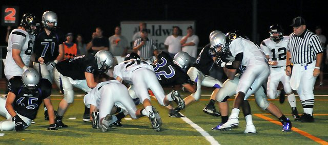 Baldwin High School senior Jake Mindez (No. 32) stretches across the goal line to score the Bulldogs' only touchdown Friday night. Baldwin lost 27-6 to Paola at home.