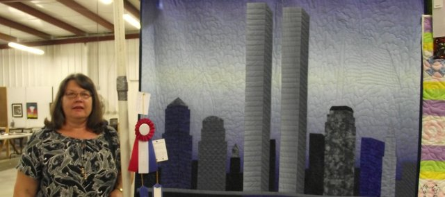 The lack of a reflection for the World Trade Center suggests its fate in this quilt Susan Morrison showed last month at the Leavenworth County Fair. The quilt won a blue ribbon and has been entered in this month's State Fair in Hutchison.