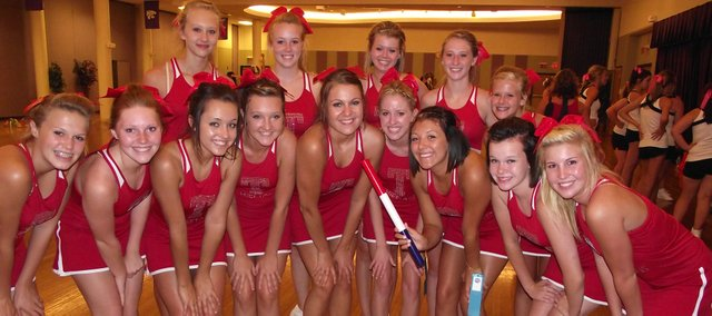 The Tonganoxie High School cheerleading squad won the Spirit Stick on two nights at summer camp in Manhattan. Pictured (from left to right) from the first night are, in back,  Kameron Robbins, Samantha Feiring, Jessa Thorne, Marissa Martin, Allison Thompson; in front,  Emily Mitchell, Haley Starcher, Amanda Shepley, Brittney Thurston, Rachel Wood, Amber Shuster, Emily Stafford, Dena Espeland and Tanna Ward.