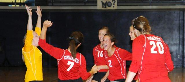 Tonganoxie High volleyball players Megan Hummelgaard, Hannah Kemp, Kailan Kuzmic, Jenny Whitledge, Madee Walker and Katelyn Waldeier celebrate in a dual victory Thursday at Baldwin.