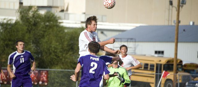 Tonganoxie High sophomore Ben Edmonds heads the ball in the second half of the Chieftains' Wednesday home match against Piper. THS won, 1-0, in double overtime.