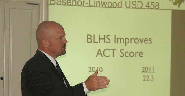 Basehor-Linwood school district superintendent David Howard speaks to Basehor Chamber of Commerce members about the district's improved ACT scores at the chamber's monthly meeting Sept. 15 at Community National Bank in Basehor.