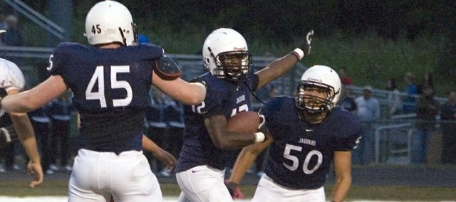 Mill Valley High senior linebacker Marcus Grant points the other way after sacking Tonganoxie quarterback Garret Elston, forcing a fumble and recovering the ball in the first quarter of the Jaguars' 63-15 win at MVHS on Friday.