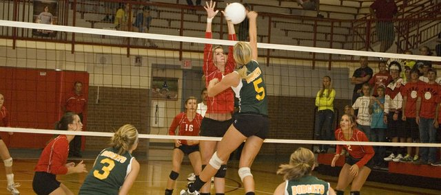 Tonganoxie High senior Brooklyn Kerbaugh goes up for a block in this Mirror file photo. The Chieftains went 3-3 and finished fifth Saturday at the Rossville Invitational.