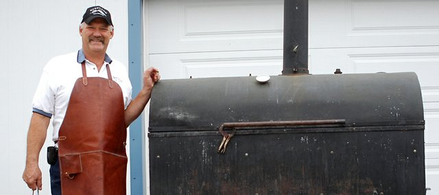 Joe Meyer built his smoker  which is big enough to cook an entire pig on a spit  himself. Meyer and his wife, Lori Meyer, are the Shawnee residents behind Overland Pig Committee, a staple at the Shawnee Great Grillers Blues &amp; Barbeque State Championship since its inception. The Meyers, who own Overland Tow Service in Merriam, will be back in action this weekend at the biggest Shawnee barbecue yet, with 114 teams expected to fire up grills Friday and Saturday at Shawnee Town 1929.